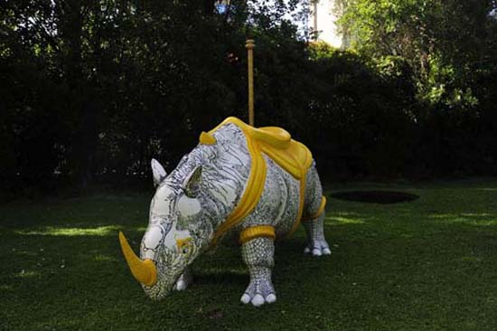 Raqs Media Collective, However Incongruous, 2011, fiberglas sulpture of a 3D rendition of Albrecht Durer's Rhinoceros transformed into a carousel carriage, (length: 10.5', height: 5.25', girth: 3'). Site-specific work for the Gulbenkian Foundation gardens in Lisbon.. Courtesy the artists' website.